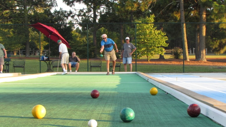 bocce ball players battle for the lead the seven lakes insider